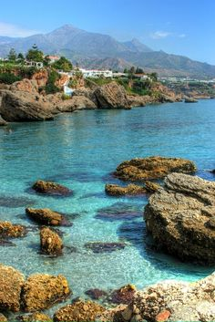 Can you imagine yourself swimming in this clear blue sea? Nerja, Andalucía... www.andalusie-zeezicht.nl