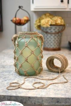 DIY Sea Glass Rope Lantern - A Wonderful Thought - DIY Sea Glass Rope Lantern. Perfect for your beach/coastal decor Pot Mason Diy, Mason Jar Crafts, Bottle Crafts, Mason Jars, Diy Crafts Jars, Pickle Jar Crafts, Mason Jar Lanterns, Diy Bottle, Rope Crafts