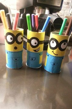 DIY minion pencil holders made out of tissue paper rolls.
