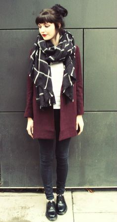 black trousers, white top, burgundy cardigan, black and white printed scarf