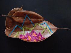 embroidery on magnolia leaves, 2011