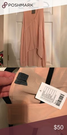 NWT Anthropologie Blush Tank Top New with Tags Anthropologie Blush Tank Top. Size L. Brand: left of center. Crepe/Silky Feel. Tunic Length. High-low hem. Beautiful for layering all year. Anthropologie Tops