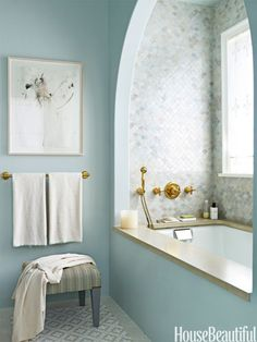 Blue Hues    Creating an idyllic bath for a Long Island home, designer DD Allen choose a blue palette but did not limit herself to one shade. The custom watery blue of the polished Venetian plaster walls picks up the blue in the floor tiles.