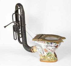 """Southeby's auction house in England put this interesting """"instrument"""" up for sale on November 25, 2003; it sold for 2,640 pounds. The """"loophonium"""" (to fully understand the name, keep in mind that the British slang name for the toilet is the """"loo""""), also known as a harpic-phone, was devised by Fritz Spiegl. It was designed for use in April Fools' Concerts which were staged in Liverpool from 1952 for over twenty five years by members of the LPO…"""