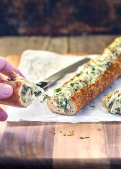 This easy, cheesy, creamy feta and spinach stuffed french bread is deliriously rich and tasty. It reminds me of a Greek spanakopita but all stuffed inside a wonderful sourdough bread loaf. Perfect hand held appetizer for parties or the holidays! www.keviniscooking.com