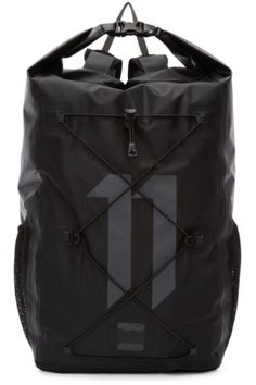 4240bb1723 Unstructured nylon and polyurethane backpack in black. Bonded seams  throughout. Carry handle at twin adjustable shoulder straps and waist  straps.