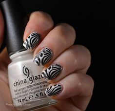 Zebra nails made with a pattern from MoYou London plate.