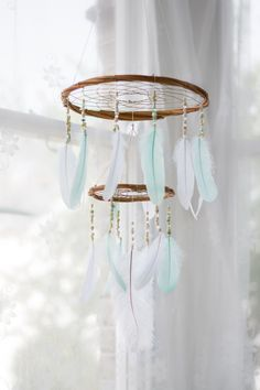 Large Mint and White Chandelier Dream Catcher Mobile - 12x18Inches Dreamcatcher Mobile Dreamcatcher Mobile Bohemian Dream Catcher Nursery Mobile Crib Mobile Cot Mobile Baby Mobile Boho Decor. Large Mint and White chandelier dreamcatcher mobile, handmade and hand woven by me. This unique piece will really stand out in your little ones nursery or in any room! DETAILS & SIZE: The large willow hoop is approx 30cm/12 inches in diameter and the smaller hoop is 15cm/6 inches. The length of the...