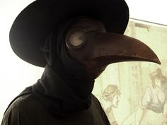 "During the plague in the Middle Ages, some doctors wore a primitive form of biohazard suit called ""plague suits"" (pictured above). The mask included red glass eyepieces, which were thought to make the wearer impervious to evil. The beak of the mask was often filled with strongly aromatic herbs and spices to overpower the miasmas or ""bad air"" which was also thought to carry the plague."