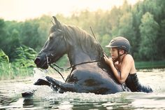 I used to do this ,with my horse,  in the Columbia River in Kennewick, WA when I was sooooo much younger!! :)  It was dangerous, but oh so much fun.