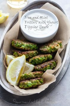 These sweet pea fritters with yogurt dipping sauce are a great snack or appetizer. #gluten-free #paleo