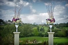 Pink, Purple, and White Ceremony Arrangements. I like this idea since it wouldn't obstruct the view of the mountains.