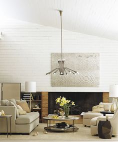 Intimate seating beneath soaring ceilings from the Barbara Barry Collection at Baker Furniture. I like this room a lot: all neutrals, yet very cozy.