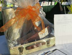 Silent auction item idea: Scotch and Cigar basket in a cute suitcase-styled box.  #SilentAuctionBaskets