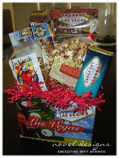 Small Viva Las Vegas Gift Basket w/Las Vegas Gummy Dice, Las Vegas Kettlecorn, Las Vegas Chocolate Bar, Las Vegas Postcard, Jack 'Snak Mix arranged in a Las Vegas theme gift basket box.