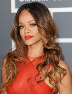 Rihanna's long wavy hair with highlights. (Fashion Gone Rogue)