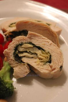 Filete de pollo relleno con espinaca, alcachofa y queso