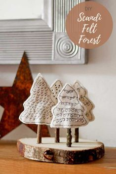 A simple but very cute felt Christmas craft. Create a mini Scandinavian forest from felt scraps and twigs and a wood slice, for your mantle. Crafts A Simple Cute Scandi Felt Christmas Craft For Your Home Scandinavian Christmas Decorations, Handmade Christmas Decorations, Felt Christmas Ornaments, Decoration Crafts, Diy Ornaments, Beaded Ornaments, Christmas Treats, Glass Ornaments, Christmas Recipes