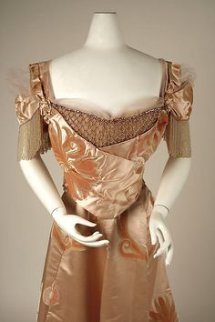 Evening dress  Design House:House of Worth (French, 1858–1956) Designer:Jean-Philippe Worth (French, 1856–1926) Date:1898–1900 Culture:French Medium:silk, glass