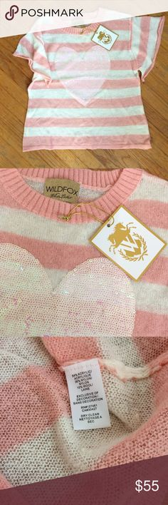 Wildfox White Label Heart Sweater (S) Wildfox White Label Heart Sweater (S)   Wildfox White Label Pink and white stripes Pink sequin heart  NWT- New with tags *This item is not eligible to be bundled via the PoshMark bundle tool. Wildfox Sweaters