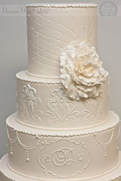 stunning wedding cake with tall top tier and intricate details, including monogram (remove flower though)