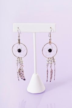 This is a silver black beaded cool look earring from Nasty Gal, jewelry to ornament the ear; usually clipped to the earlobe or fastened through a hole in the lobe.