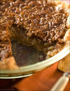 Maple-Bourbon Pecan Pie - Maple syrup coaxes the pie into its not-too-sugary perfection with a hit of good ol' Kentucky bourbon.
