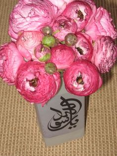 Calligraphy printed on Vellum and wrapped around a vase for a beautiful display