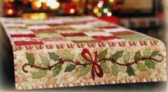 What a pretty edge on this table runner! https://www.vintageandvogue.com/Holly-Berries-Table-Runner-Quilt-Pattern-by-Shab-p/sf-holly-berry-table-runner.htm