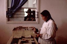 Eve Arnold - China. Pharmacist filling prescription. 1979.