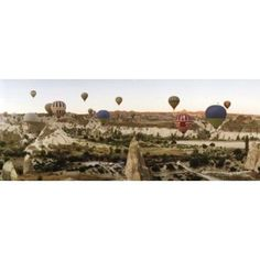 Hot air balloons over landscape at sunrise Cappadocia Central Anatolia Region Turkey Canvas Art - Panoramic Images (15 x 6)