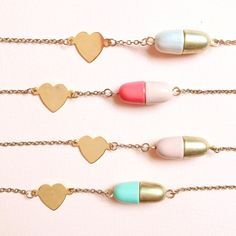 love pill necklace. $18.00, via Etsy.