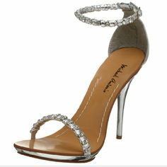 """Michael Antonio Women's Touch Dress Sandal HTF WORN ONE TIME INSIDE for photo shoot LIKE NEW  For something that has such a """"barely-there"""" look, this Touch sandal from Michael Antonio certainly does stand out. The metallic leather-like upper is covered in sparkling stones which will attract attention with every step, and that daring spiked heel will make your gams look neverending. Plus, the insole is fully contoured so strutting will be a cinch!  * Manmade upper & sole * Heel measures…"""