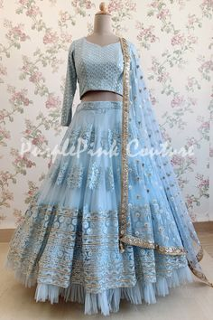 Lehenga Choli are the most preferred Indian Ethnic Wear for Woman. This Ice Blue Net Base Thread Embroidered Lehenga Choli is unique color and style. Designer Party Wear Dresses, Indian Designer Outfits, Indian Designers, Designer Wear, Choli Designs, Lehenga Designs, Blouse Designs, Indian Lehenga, Lehenga Choli
