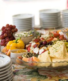Can't go wrong with fruit, cheese, and bread and olives! Buy sample sized cuts to try new ones -- YUM!