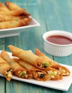 Paneer Chilli Cigars, crispy rolls with a cheesy and spicy paneer stuffing is an interesting starter, especially for dinner on a winter's night. Indian Appetizers, Indian Snacks, Appetizers For Party, Indian Food Recipes, Vegetarian Recipes, Snack Recipes, Cooking Recipes, Rice Recipes, Party Snacks