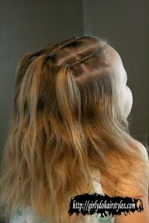 Embracing the Waves  Twist back sections into small ponytails and let her waves hang freely.   Find out more at Girly Do Hairstyles.