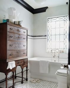 Victorian bathroom design with white bathtub antique wood storage traditional floors white walls of Give the Neutral & Natural Touch Just by Involving Wooden Furniture Around the House