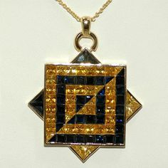 This stunning pendant magnificently exhibits 15 ct of yellow sapphires and 15 ct of blue sapphires set in 18K yellow gold. Designed by Tsajon, this piece represents the balance of the universe. Through the careful alignment of yellow and blue sapphires, this pendant expresses the concept of duality or Yin and Yang.