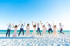 jumping bridal party beach wedding picture