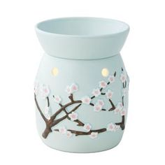 Cherry Blossom Full-Size Scentsy Warmer PREMIUM    With raised branches and detailed blossoms set against the softest of blues, Cherry Blossom brings a breath of fresh air to any room.