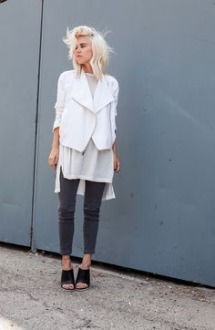 architectural white jacket with skinny black jeans and heels