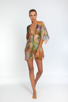 This stunning 100% silk chiffon kaftan comes in a gorgeous multi-coloured kaleidoscope design. Its empire line cut gives it shape and definition, while its plunging embellished neckline, open kimono embellishedRead more »