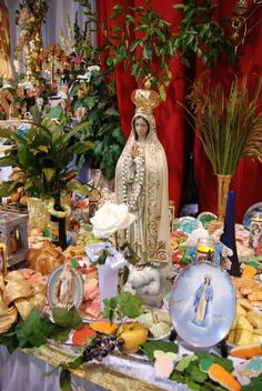 At this, the largest St. Joseph Altar in Louisiana, devotions such as the Blessed Mother, Sacred Heart, and various saints are organized in sections. This is the Blessed Mother area. St. Joseph Church, Gretna, LA. Photo by Christie Bourg