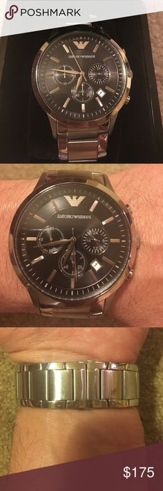 Emporio Armani Men's Silver Watch This watch has been lightly worn and comes with all the original paperwork, including the links I had removed so you can resize it if needed. Let me know if you have any questions. Emporio Armani Accessories Watches