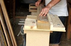 Using a straight edge and home-made router table to remove warp from pallet plank.