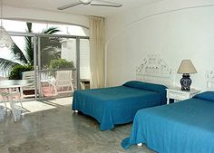 Terrace suite with double beds at Dolphin Cove Inn- Manzanillo, Mexico