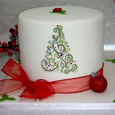 """""""Hand painted abstract Christmas tree with edible color on a fondant covered gingerbread cake filled with vanilla swiss meringue buttercream and white chocolate ganache."""""""