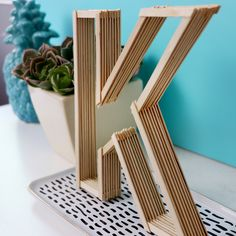 DIY Letters made from Coffee Stirrers - Easy Room Decor - Karen Kavett Diy Crafts For Home Decor, Diy Crafts Hacks, Diy Arts And Crafts, Diy Wall Decor, Diy Crafts To Sell, Homemade House Decorations, Craft Stick Projects, Diy Popsicle Stick Crafts, Craft Sticks