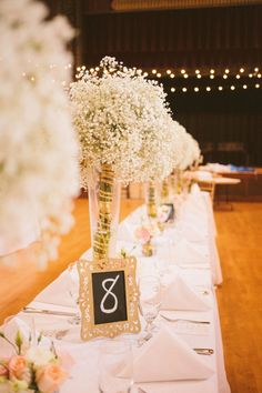 Love the tall vases so people can still see across the table and the baby's breath so cheap and beautiful!